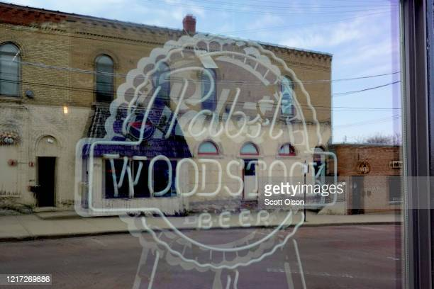 A beer sign hangs in the window of a shuttered bar near the town square on April 06 2020 in Woodstock Illinois Most of the small businesses in the...