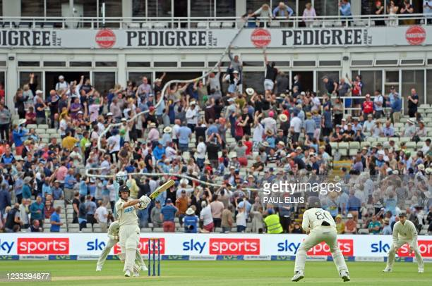 Beer snake' is passed through the crowd as New Zealand's Will Young bats during the second day of the second Test match between England and New...