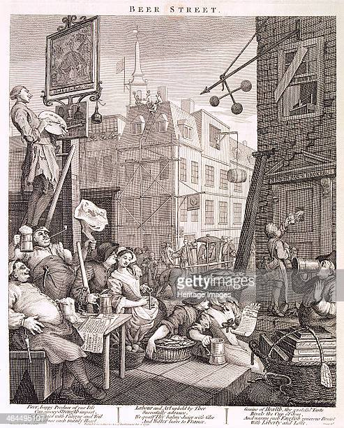 'Beer Street' 1751 Working people enjoying a tankard of beer outside the Barley Mow public house The figures include two women with baskets of fish...