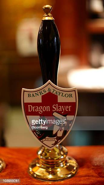 A beer tap displays the BT Brewery Ltd produced Dragon Slayer logo at the Lord Moon of the Mall pub operated by JD Wetherspoon Plc in London UK on...