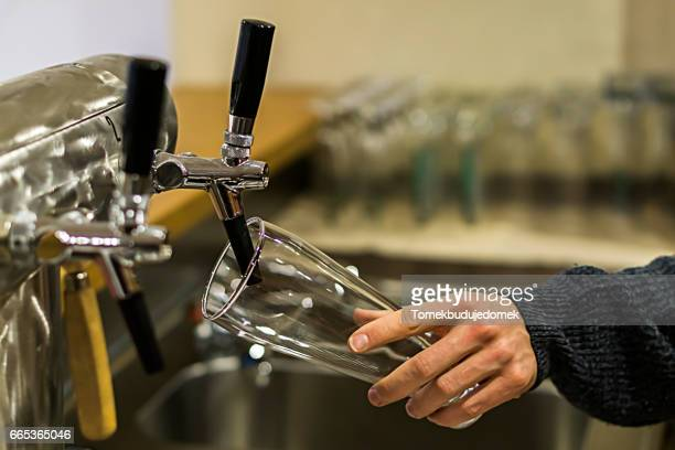 beer tap - variable schärfentiefe stock pictures, royalty-free photos & images