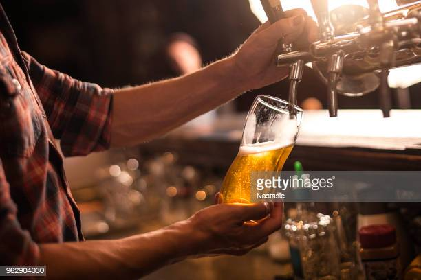beer tap - pouring stock pictures, royalty-free photos & images