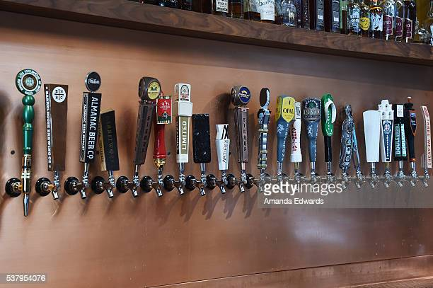 Beer taps are seen at the DGA Luncheon during the 2016 Los Angeles Film Festival at City Tavern on June 3 2016 in Culver City California