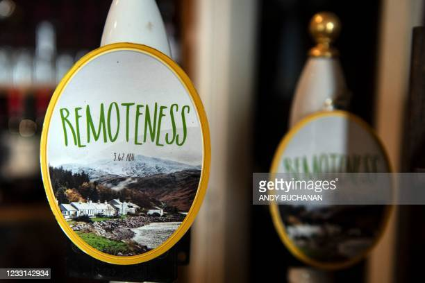 Beer taps for the Loch Ness Brewery's 'RemoteNess' ale are picture in the bar at The Old Forge pub in Inverie on the Knoydart peninsular in the...