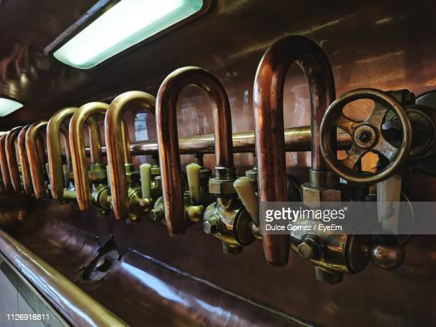 beer taps in brewery - plzeň stock pictures, royalty-free photos & images