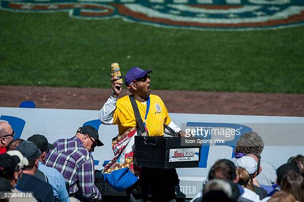 A beer vendor walks the aisle during a regular season Major League Baseball game between the Chicago Cubs and the Colorado Rockies at Coors Field in...