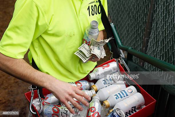 A beer vendor works around the parthree 16th hole during the third round of the Waste Management Phoenix Open at TPC Scottsdale on January 31 2015 in...