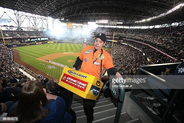 A beer vendor works section 331 during the game between the Oakland Athletics and the Seattle Mariners during the Mariners' home opener at Safeco...