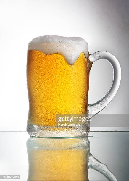 Beer with head in glass with handle
