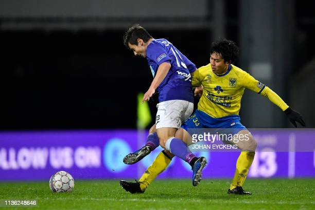 Beerschot's Dante Vanzeir and STVV's Wataru Endo fight for the ball during a soccer match between KFCO Beerschot Wilrijk and SintTruidense VV...