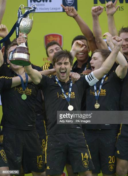 Beeston's Adam Dixon lifts the trophy after their victory over East Grinstead in the NOWPensions Hockey League Championship Final at Reading Hockey...