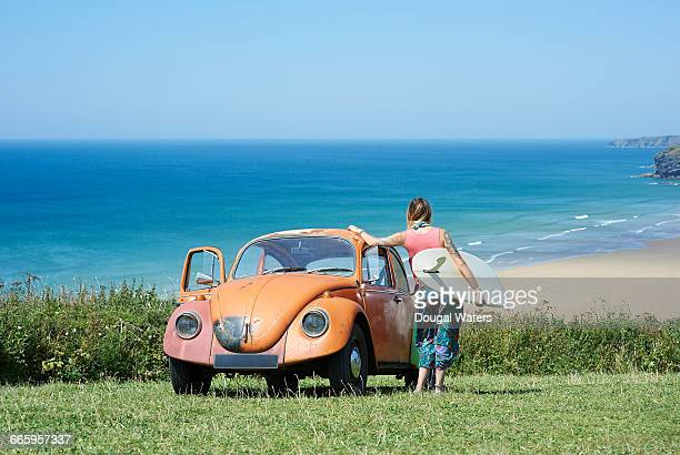 VW Beetle and surfer.