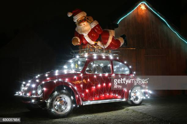 Beetle ca is decorated with lights in Ertingen southern Germany on December 15 2016 / AFP / dpa / Thomas Warnack / Germany OUT