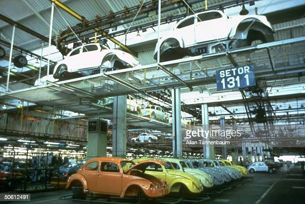 Beetle car bodies lining floor of Volkswagen production plant re 1993 mfg resumption by on Autolatina after 1986 phase out