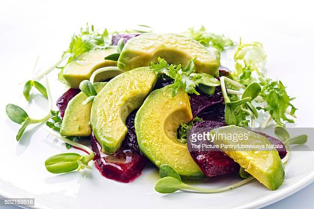 Beetroot and avocado salad with lemon and Fresh sunflower sprout