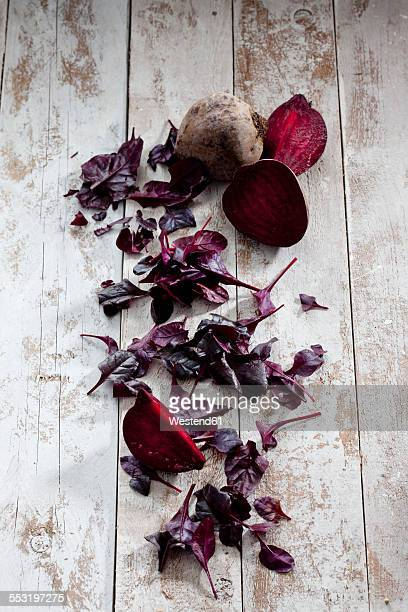 Beetroot and leaves on wood