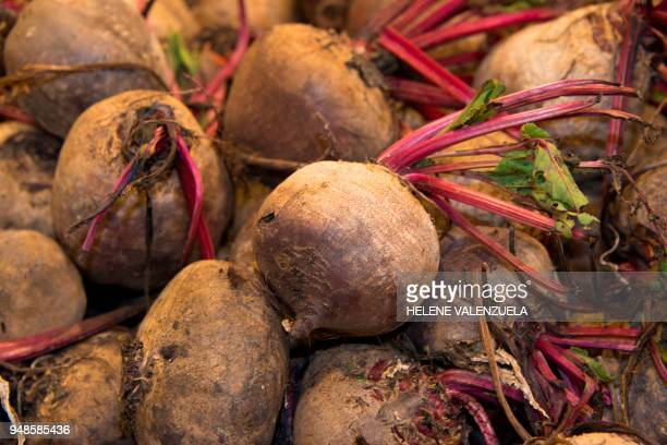 Beetroot bulbs are pictured at the fruit and vegetable department of an 'O Marche' supermarket in SaintFrancois on the French overseas territory of...