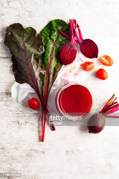 beetroot juice and fresh beetroot,detox vegan smoothies from raw beets and tomato - antioxidant stock pictures, royalty-free photos & images