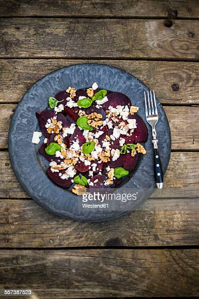 Beetroot salad with feta cheese, walnuts and basil on plate