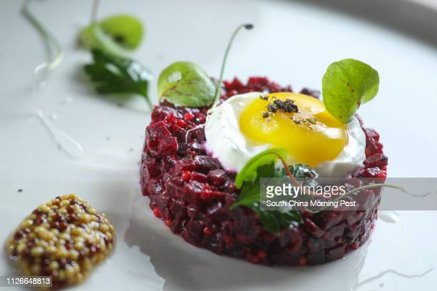 Beetroot tartare with quail egg yolk mustard seeds and fried potatos' at Mano G/F The L Place 139 Queen's Road Central 26SEP14 [FOOD REVIEW 48HRS]