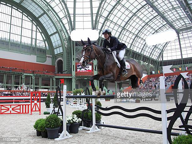 Beezie Madden and her horse Coral Reef Via Volo clear an obstacle at the Saut Hermes International Show Jumping Competition in Paris on April 15 2011...