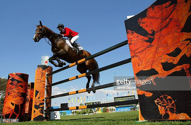 Beezie Madden of USA rides Authentic over a jump during the individual show jumping event on August 24 2004 during the Athens 2004 Summer Olympic...