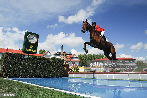 Beezie Madden of USA riding Simon competes in the individual jumping equestrian on the final day of the Masters tournament at Spruce Meadows on...