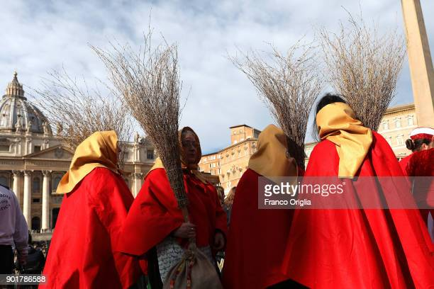 Befanas gather in St Peter's Square during the Feast of the Epiphany to attend the Pope Francis' Angelus blessing on January 6 2018 in Vatican City...