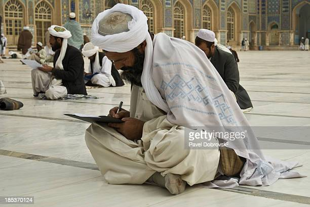 Befor the prayer In Herat's Friday mosque men are learning how to read and write after decades of civil wars in Afghanistan.