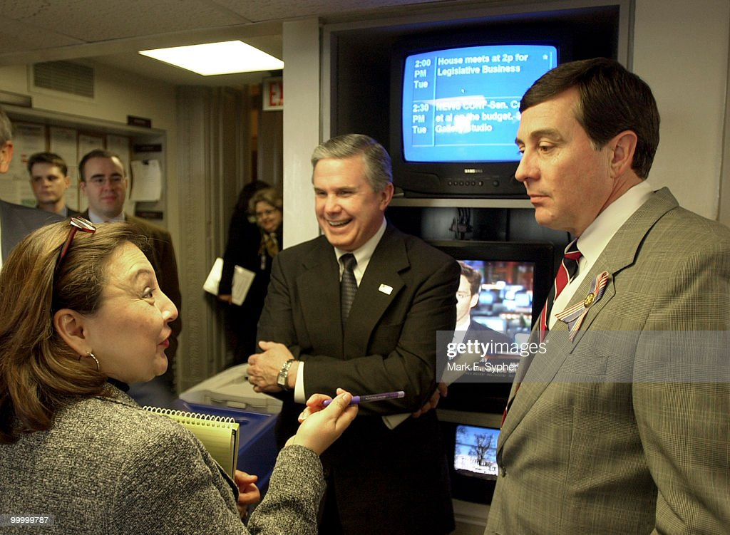 Before a news conference on 'Securing America's Future for Agriculture FY2003 Budget Resolution,' Rep. Larry Combest (R-TX) and Rep. Gil Gutknecht (R-MN) are joined by a reporter while Rep. Gutknecht gives instructions on how to become a great auctioneer, which Rep. Gutknecht did before coming to Capitol Hill.