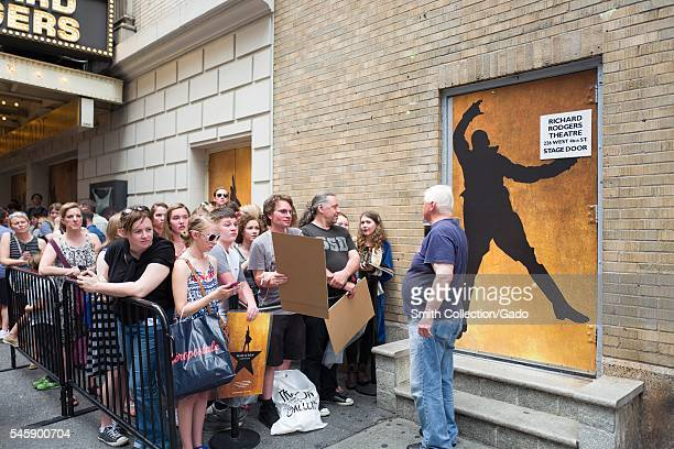 Before a performance of the Broadway musical Hamilton two days prior to creator Lin Manuel Miranda's departure from the show, a security guard stands...