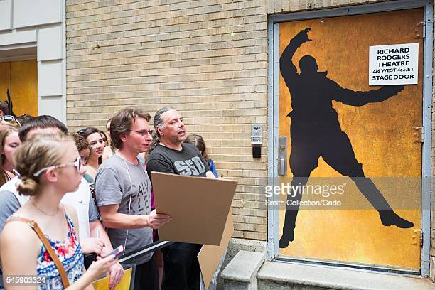 Before a performance of the Broadway musical Hamilton two days prior to creator Lin Manuel Miranda's departure from the show, fans hold homemade...