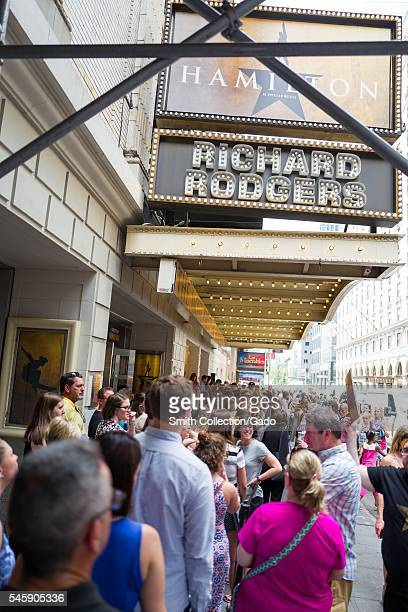 Before a performance of the Broadway musical Hamilton two days prior to creator Lin Manuel Miranda's departure from the show, fans stand in line and...