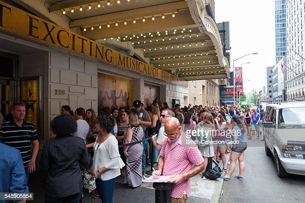 Before a performance of the Broadway musical Hamilton two days prior to creator Lin Manuel Miranda's departure from the show, fans stand in line in...