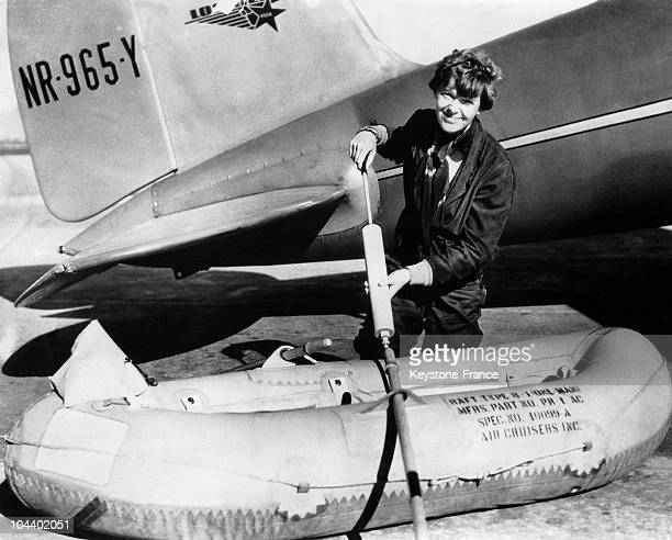 Before beginning her flight around the world the pilot Amelia EARHART pumped her inflatable lifeboat from the equipment of her plane FLYING...
