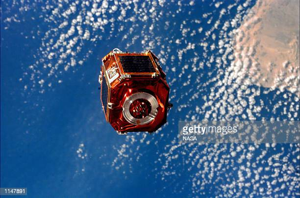 Before beginning their presleep period on their next to last day in space, the STS-88 astronauts deployed a small 590-pound satellite called SAC-A...