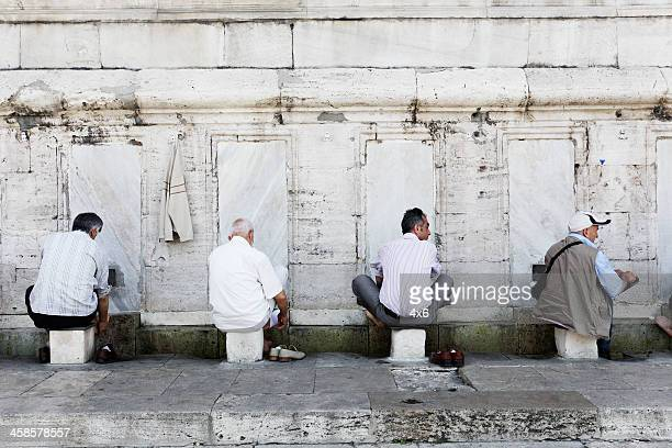 before entering mosque - namaz stock pictures, royalty-free photos & images