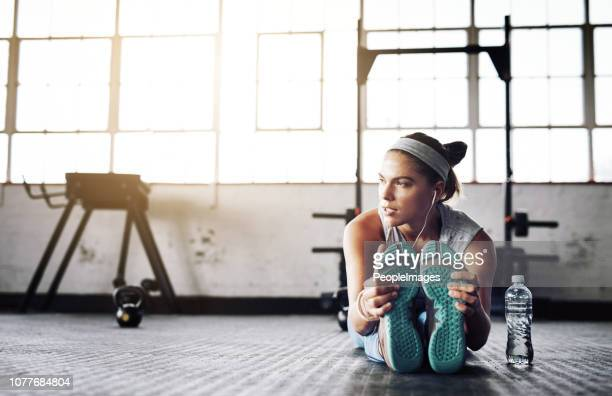 before exercising always stretch - center athlete stock pictures, royalty-free photos & images