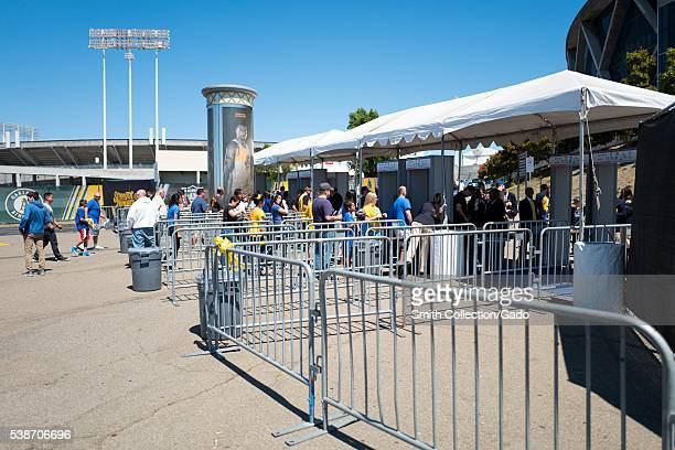 Before Game 2 of the National Basketball Association Finals between the Golden State Warriors and the Cleveland Cavaliers fans enter metal detectors...