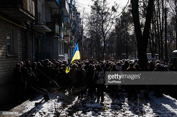 Before going to the cemetery, people stop by Igor Tolmatchev's house on February 25, 2014 in Kharkiv.