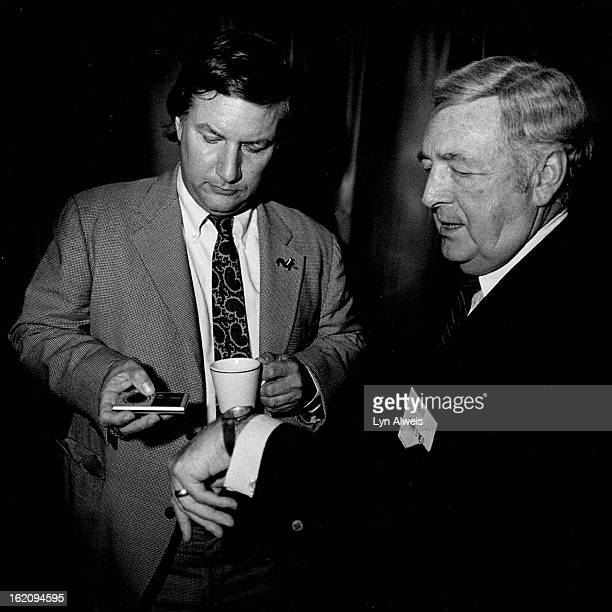 AUG 13 1984 AUG 14 1984 Before his talk to the American Hospital Assoc Thomas Peters synconizes his watch with program producer Danny 0*Neil at...