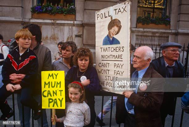 Before it erupts into a fullscale riot families protest against Margaret Thatcher's Poll Tax policy on 31st March 1990 in Trafalgar Square London...