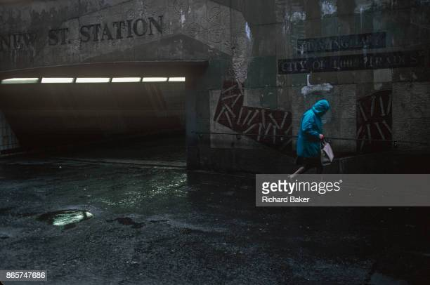 Before its redevelopment in 2000 a lady shopper walks through the grim underpass of the Midland's infamous Bullring shopping centre on 12th October...