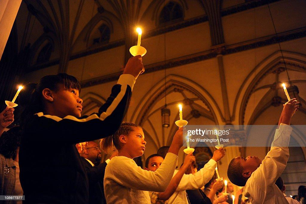 Baptism at St. Augustine's Catholic Church : News Photo