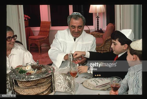 Before Seder begins Rabbi Jack Frankel and his guests observe a traditional service They are guided through this service by means of a narrative...