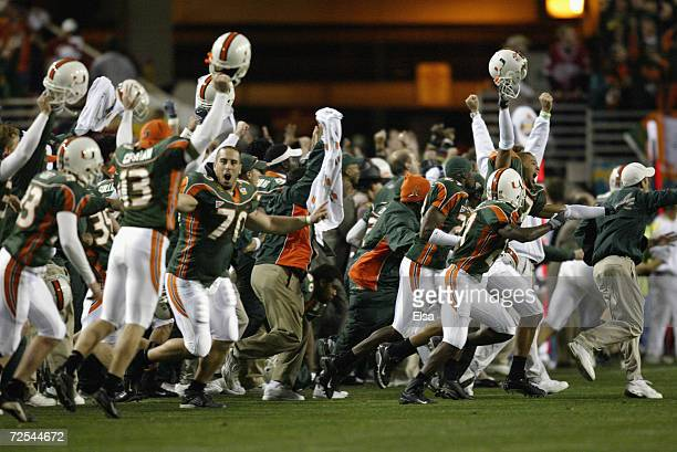 Before seeing the flag thrown by an official the Miami Hurricanes players and the coaches celebrate at the end of the first overtime against the Ohio...