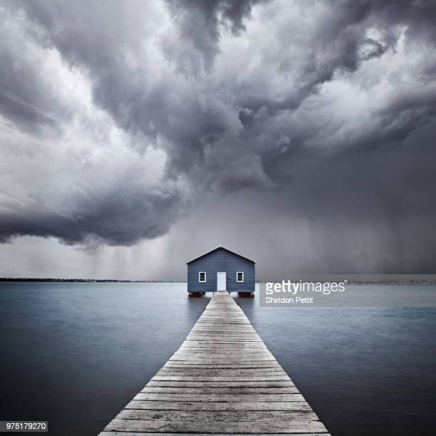 before storm, lake - footbridge stock photos and pictures