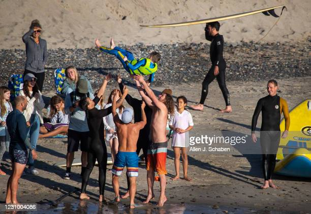 February 05: Before surfing with Pismo The Kid surfing goat a group of surfers toss up Cohen Schuller of Costa Mesa, who is recovering from a brain...
