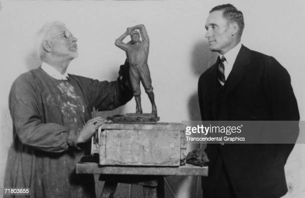 WASHINGTON OCTOBER 2 1924 Before the 1924 World Series begins Senators pitcher Walter Johnson poses for sculptor USJ Dunbar