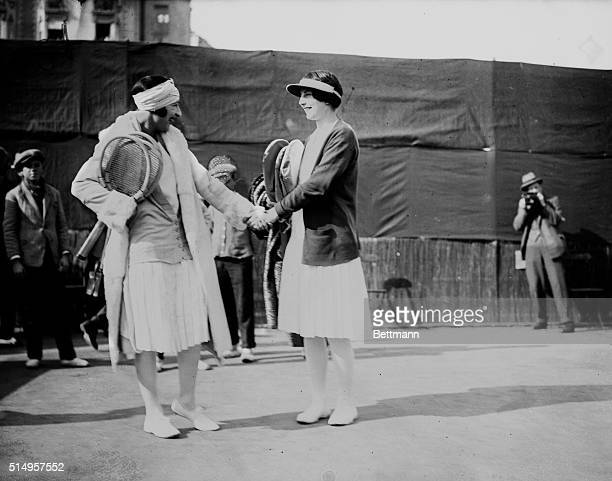 Before the battle of centuryHelen Wills and Suzanne Lenglen are seen shaking hands before the tennis matches at Cannes in which Miss Wills lost to...